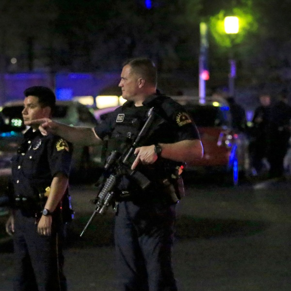 Dallas police stand watch near the scene where four Dallas police officers-3156084