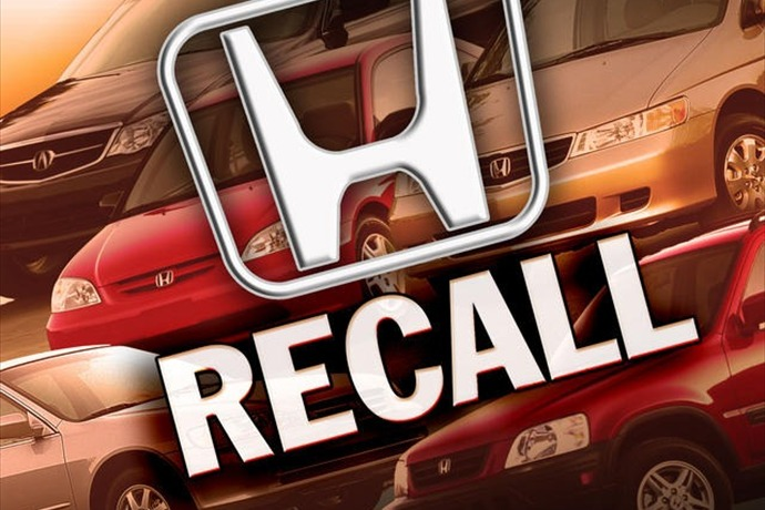 Honda recalls nearly 900,000 minivans._-4158549868807503290