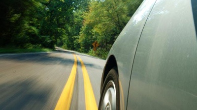 green-hybrid-car-driving-down-road-jpg_20161024200424-159532