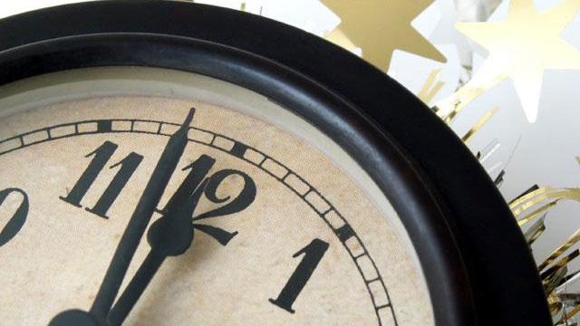 New Year's Eve clock striking midnight_669731034988197-159532