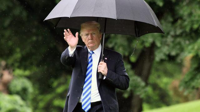 Donald Trump holds umbrella_1526579504029.jpg_370480_ver1.0_640_360_1528992550768.jpg.jpg