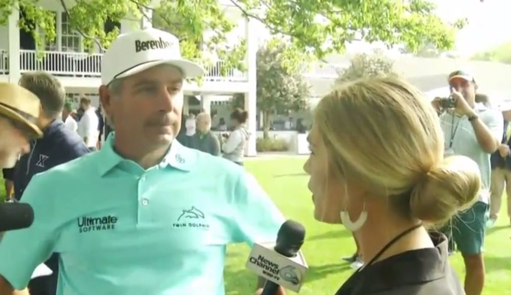 Reporter and Fred Couples_1554909239157.JPG-118809306.jpg